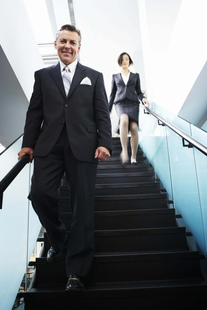 Businessman on stairs.